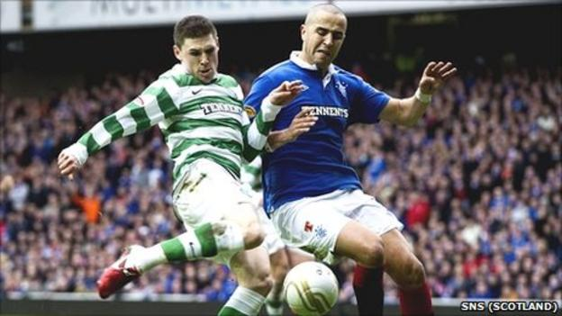 Gary Hooper of Celtic and Madjid Bougherra battle for possession