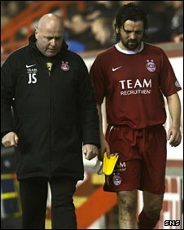 Paul Hartley goes off injured against St Mirren
