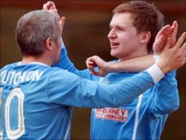 Gary McCutcheon congratulates Ryan Berry after his goal against Newry