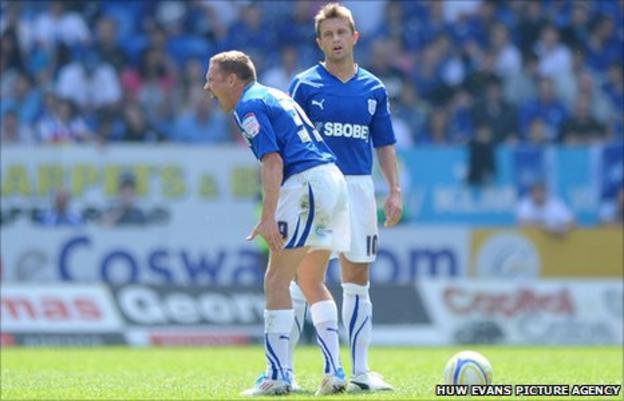 Craig Bellamy bellow orders against QPR as Stephen McPhail looks on