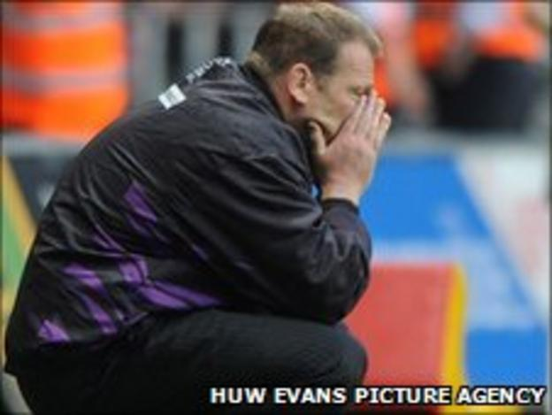 Ospreys forwards coach Jonathan Humphreys shows his dejection after losing to Munster