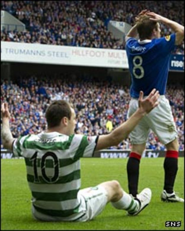 Anthony Stokes wins a penalty after a challenge from Steven Davis