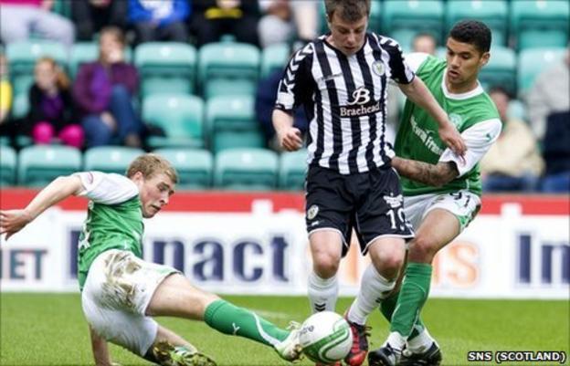 Paul McGowan (centre) won St Mirren's penalty just before half-time