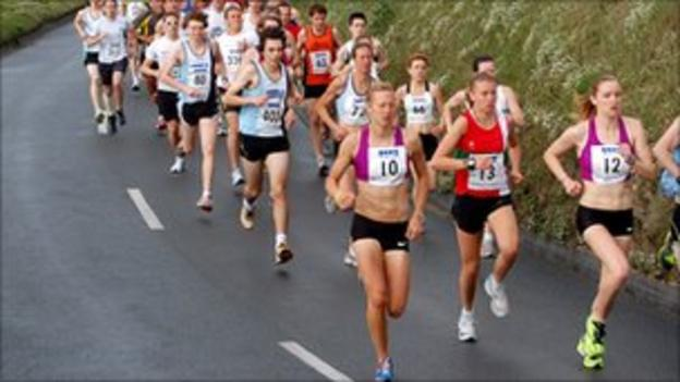 Runners on Guernsey's west coast
