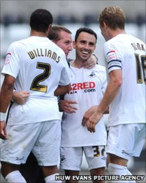 Swansea boss Brendan Rodgers celebrates with his players