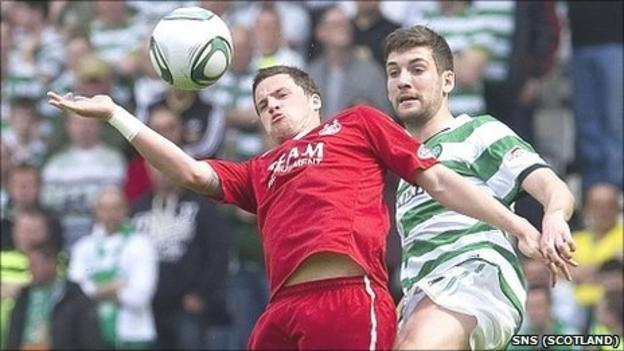 Celtic's Charlie Mulgrew challenges former Aberdeen team-mate Chris Maguire for the ball