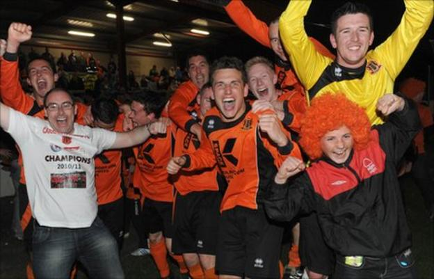 Celebrations for Carrick Rangers after clinching a league and cup double