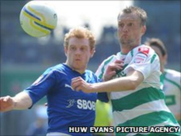 Cardiff City's Chris Burke battles with QPR's Clint Hill