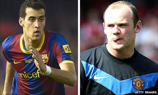 Sergio Busquets and Wayne Rooney