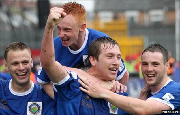 Peter Thompson, Robert Garrett, Mark McAllister and Jamie Mulgrew celebrate the winning goal in the cup final against Crusaders