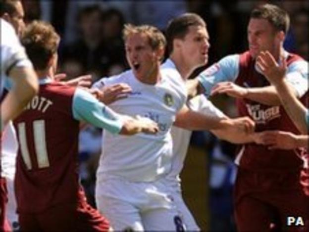 Leeds United's Neil Kilkenny confronts Burnley's Chris McCann
