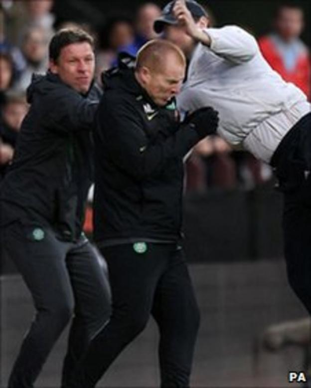 Celtic boss Neil Lennon is attacked during the game against Hearts