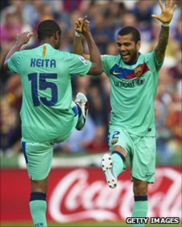 Seydou Keita and Dani Alves (right)