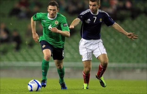 Corry Evans in action against Scotland
