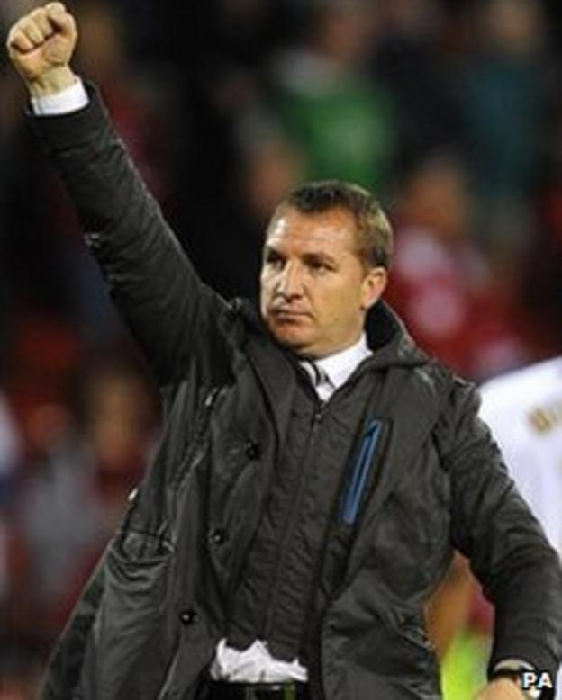 Swansea boss Brendan Rodgers punches the air after their battling draw at Forest