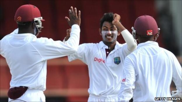 Devendra Bishoo celebrates taking a wicket
