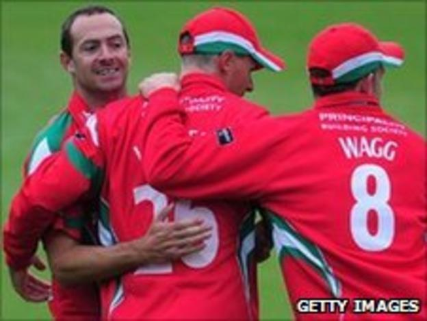 Bowler Dean Cosker (left) celebrates with his Glamorgan team-mates