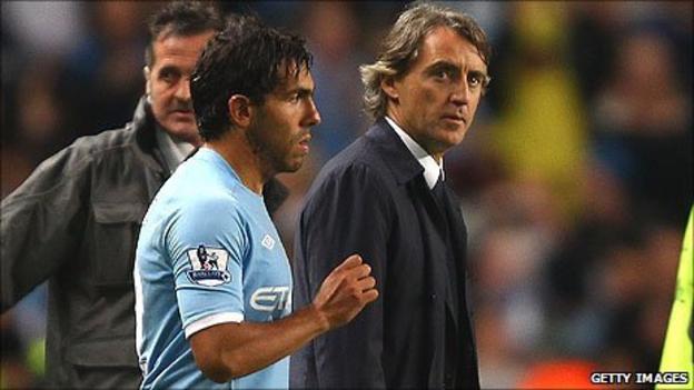 Carlos Tevez (left) and Roberto Mancini