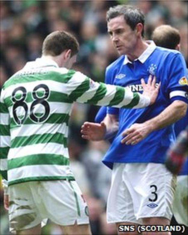 Celtic striker Gary Hooper pushes Rangers captain David Weir