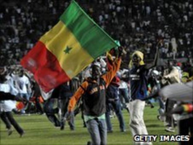 A Senegal fan celebrating