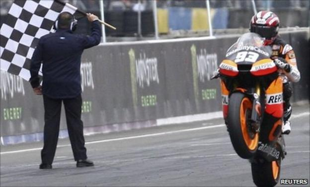 Suter's Moto2 rider Marc Marquez of Spain crosses the finish line of the MotoGP French motorcycling Grand Prix at the Le Mans circuit