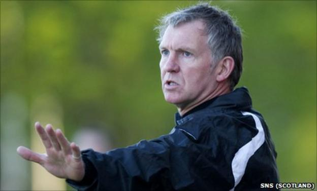 Queen of the South manager Kenny Brannigan