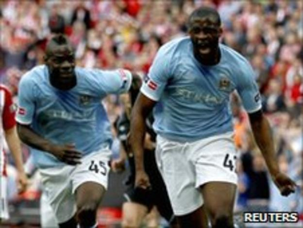 Yaya Toure (R) celebrates scoring the winning goal in the FA Cup final
