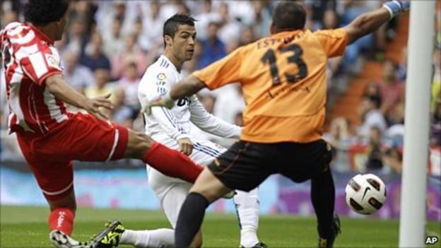 Cristiano Ronaldo slots past Almeria goalkeeper Esteban Andres Suarez