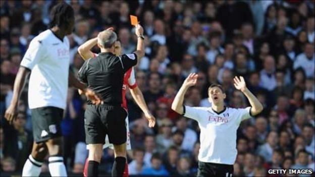 Zoltan Gera (far right) despairs as he is sent off