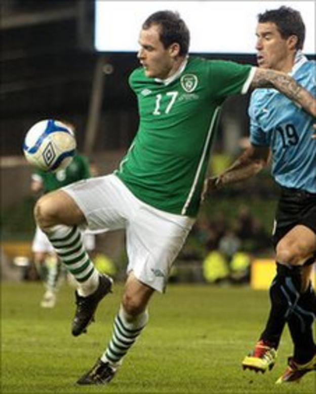 Anthony Stokes (left) and Uruguay's Andres Scotti