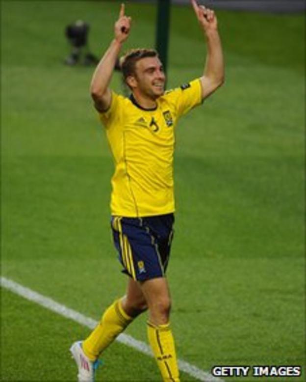 James Morrison celebrates after scoring Scotland's equaliser