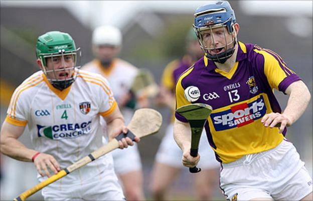 Kevin Molloy of Antrim is left behind as Wexford's Rory Jacob goes on the attack