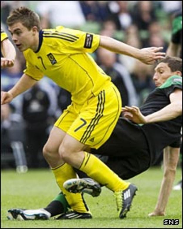James Forrest (left) is tackled in Dublin
