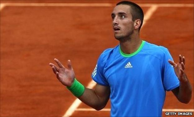 Viktor Troicki gestures to the umpire after the ball boy incident