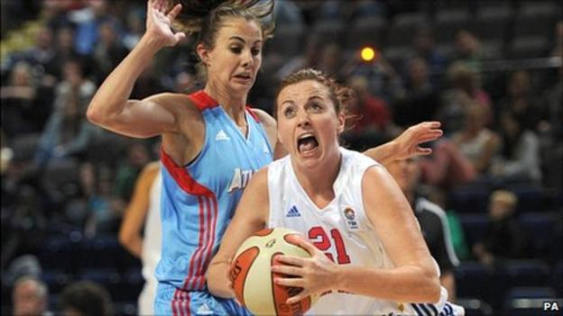 Rose Anderson drives past Shalee Lehning