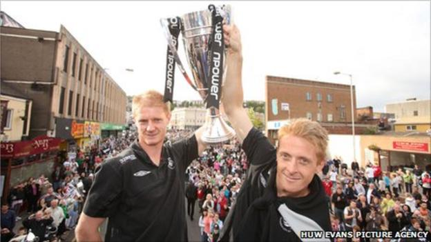 Alan Tate and Garry Monk celebrate Swansea's play-off victory