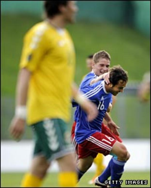 Nicolas Hasler and Philippe Erne celebrate against Lithuania