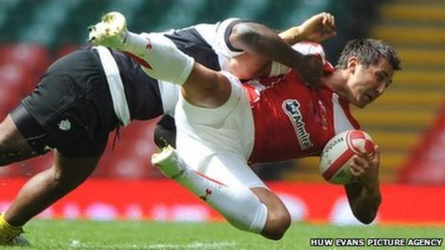 Gavin Henson is tackled by rival Barbarians centre Seru Rabeni on his Wales return