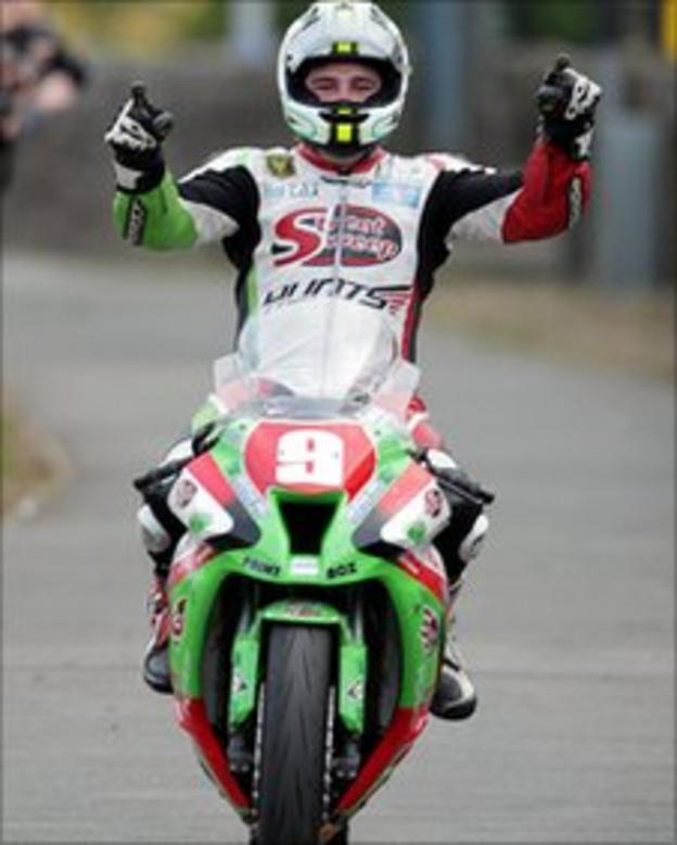 Michael Dunlop celebrates his Superstock victory in the Isle of Man TT