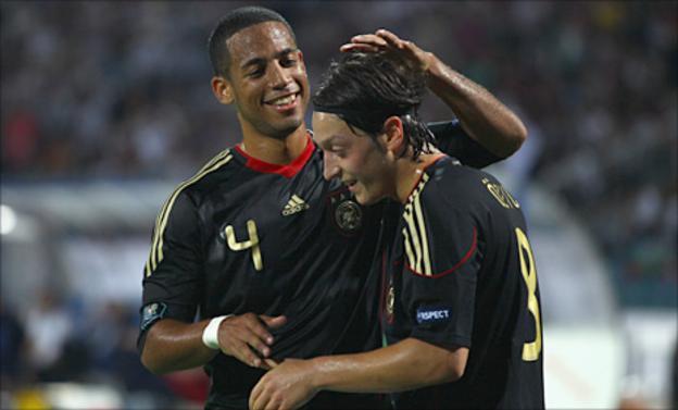 Dennis Aogo (l) and Mesut Ozil celebrate Germany's opening goal