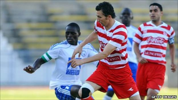 Captain of Kenyan club Sofapaka James Situma (in white) in action against Club Africain