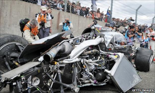 The mangled wreckage of Allan McNish's Audi R18