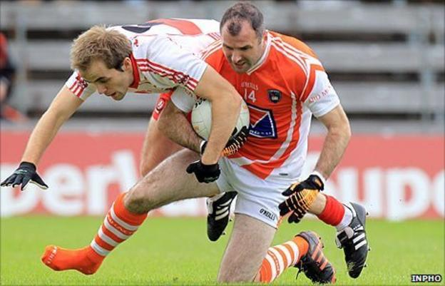 Derry's Brian Og McAlary challenges Armagh skipper Stevie McDonnell