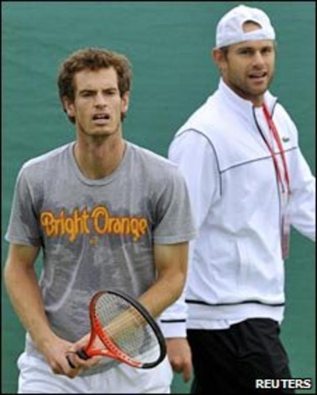 Andy Roddick (right) keeps a close eye on potential opponent Andy Murray
