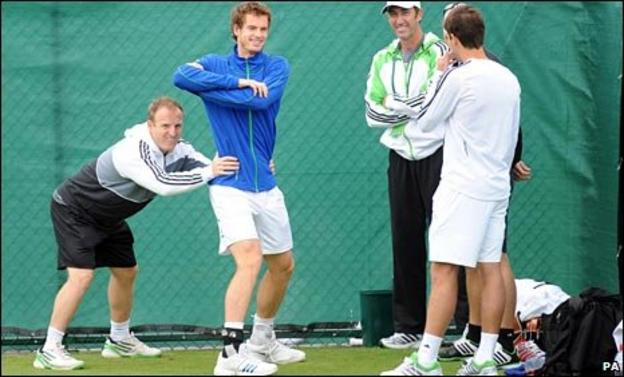Andy Murray jokes about with his entourage