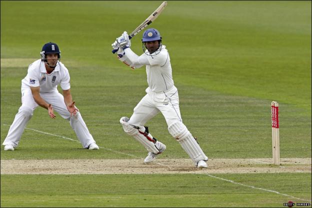 Alastair Cook looks on Kumar Sangakkara plays a shot for Sri Lanka