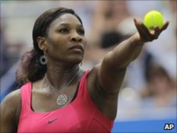 Serena Williams prepares to serve