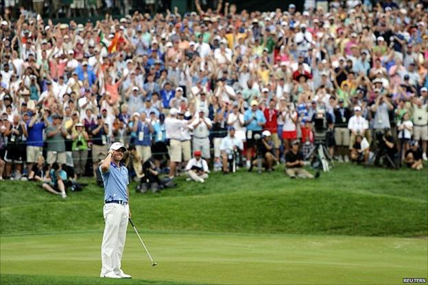 Rory McIlroy celebrates winning the US Open