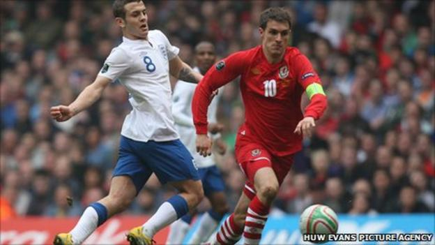 England's Jack Wilshere takes on Aaron Ramsey of Wales