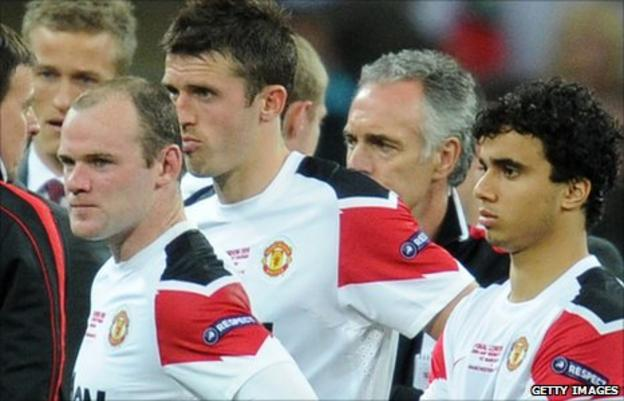 Wayne Rooney (left), Michael Carrick and Fabio da Silva